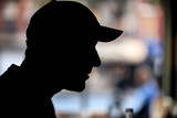 Male in baseball cap, silhouette