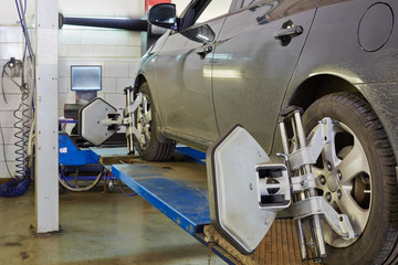 Car on stand for precision wheel alignment