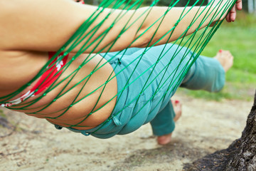 Female body in hammock