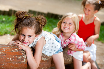 Three girl friends having fun in park.