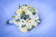 wedding bouquet on the white wedding dress