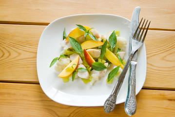 Salad with peach, cauliflower, chicken breast