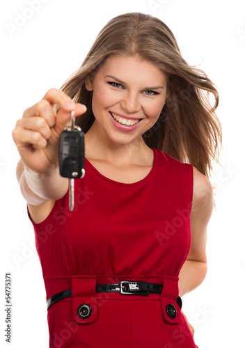 Happy blonde holding car key, isolated on white background