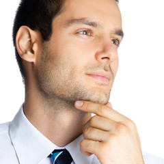 Portrait of thinking businessman, on white