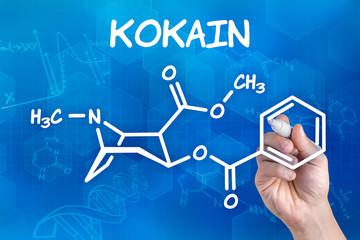 Hand zeichnet chemische Strukturformel von Kokain