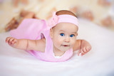 funny baby girl in a pink dress