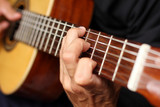 close up acoustic guitar in musician hands