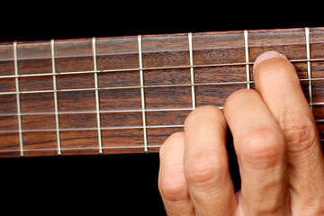 hand, hold a chord on the guitar fretboard, vibrating string