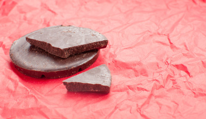 Dark chocolate on red holiday background