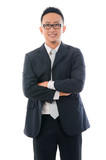 confident looking malay business man isolated on white backgroun