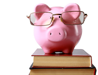piggy bank with glasses and bookin isolated white background