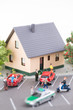 Town house, miniature people and cars on a busy street