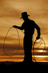 Cowboy silhouette hold rope loop