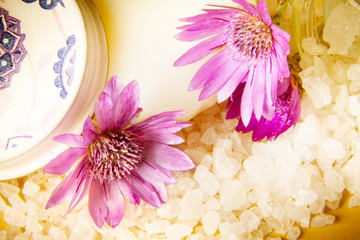 Jar of bath sea salt, soap and violet flowers