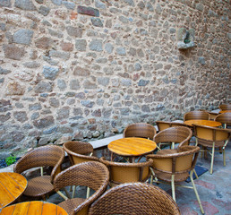summer cafe near the ancient stone wall