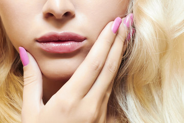 lips,nails and hair of beautiful blond woman. face without eyes