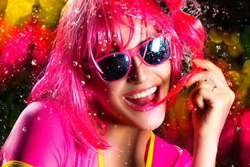 Stylish Party Girl Expressing Happiness. Water Splash