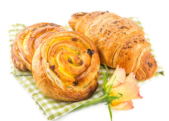 fresh pastry and croissant isolated over white background