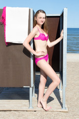 slim beautiful woman in dressing cabin on the beach