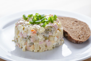 russian salad olivier served with onion
