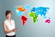 Young woman holding a phone and presenting colorful world map
