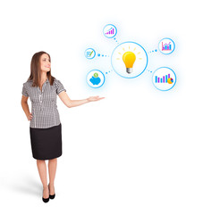 Young woman presenting light bulb with colorful graphs and diagr