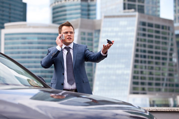 Businessman near a car
