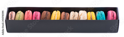 Box of colorful macaroons isolated on white background