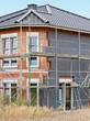 canvas print picture - Ein Neubau wird aussen mit Wärmedämmung verkleidet