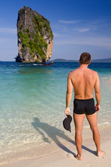 Man on the coast Andaman Sea, Koh Poda Thailand
