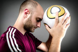 Soccer Player Holding Ball to Head