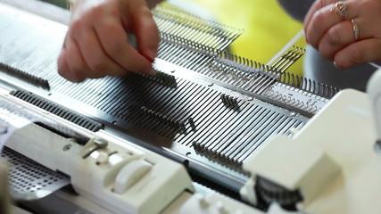 View of knitter working on machine