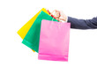 hand holding colorful shopping bags