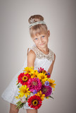 Beautiful little girl in princess dress  with flowers