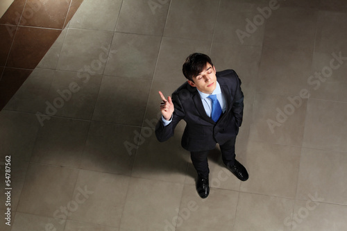 Young businessman with his eyes closed