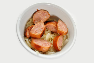 Kielbasa and Sauerkraut in a White Bowl
