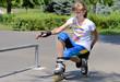 Teenage girl balancing on her rollerblades