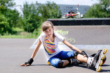 Young rollerblader taking a rest