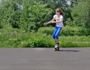Teenage girl practising her rollerblading