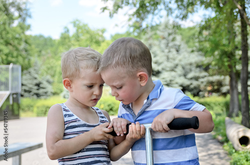 Two young boys arguing