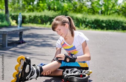 Skater nursing an injured knee