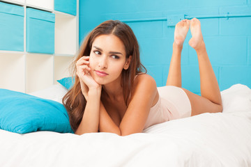 brunette woman on her bed