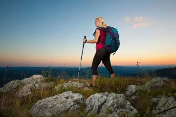 Woman on trekking - Beautiful blonde girl hiking on mountains