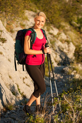 Woman on trekking - Beautiful blonde girl hiking on mountains