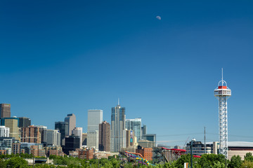Denver Colorado skyline with moon and carnival