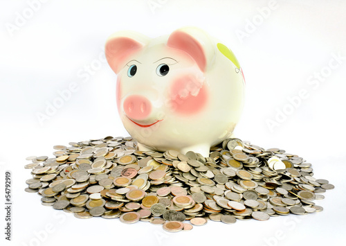 Pink piggy bank with many coins