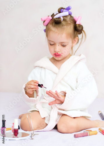 little girl painting nails