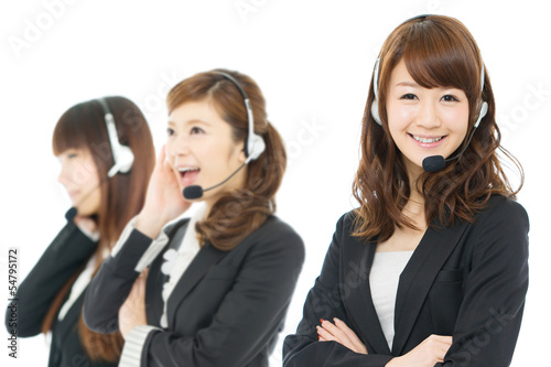 Beautiful asian business operator isolated on white background