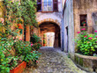 Arched cobblestone street in a Tuscan village, Italy - 54795343