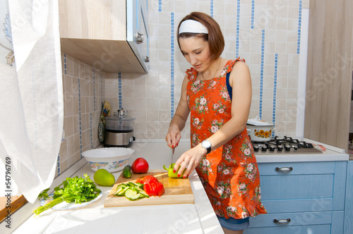 canvas print picture woman prepares a salad